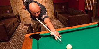 Man playing pool at The Summit