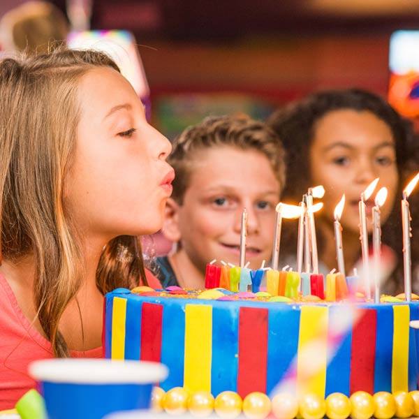 Kids' Birthday Parties at The Summit - girl blowing out candles